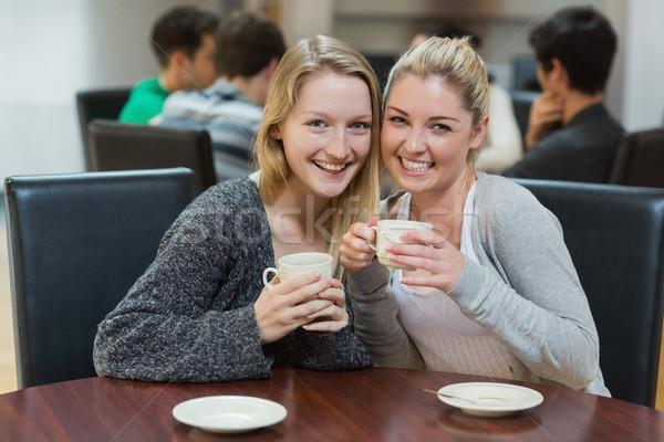 женщины сидят кофейня улыбаясь Сток-фото © wavebreak_media