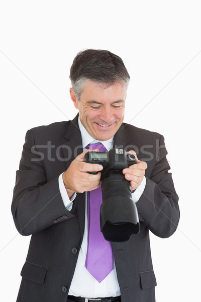 Laughing man viewing photos which on digital camera Stock photo © wavebreak_media