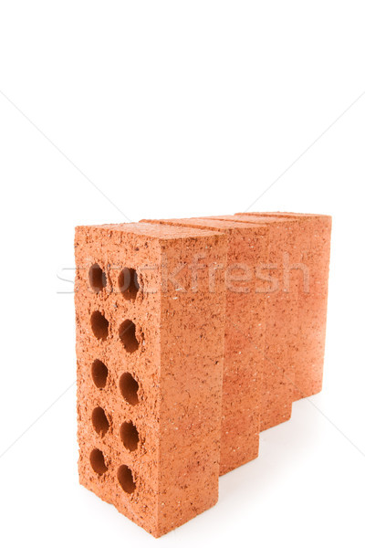 Four clay bricks positioned in a row against a white background Stock photo © wavebreak_media