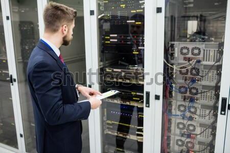 Technician phoning while repairing a server Stock photo © wavebreak_media