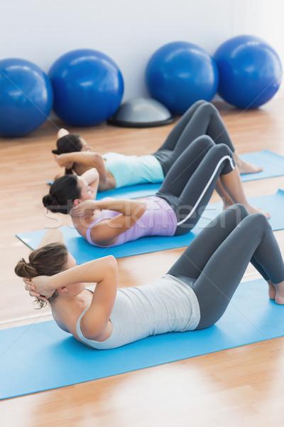 Határozott nők ül fitnessz stúdió fiatal nők Stock fotó © wavebreak_media