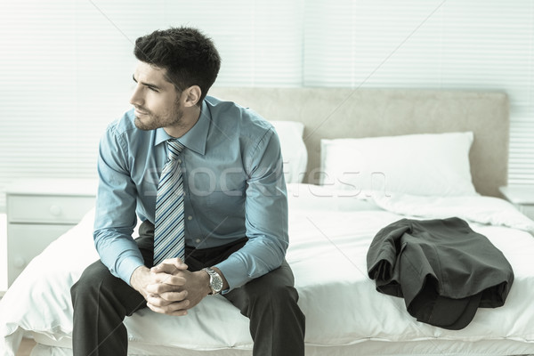 красивый бизнесмен сидят кровать мышления домой Сток-фото © wavebreak_media