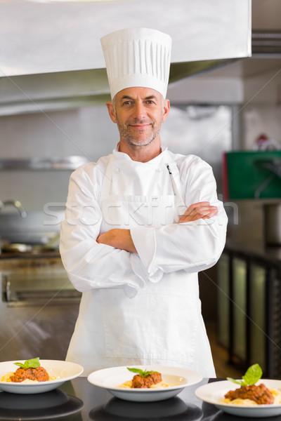 Confident male chef with cooked food in kitchen Stock photo © wavebreak_media