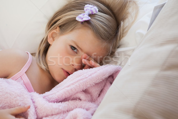 Közelkép portré aranyos lány pihen kanapé Stock fotó © wavebreak_media