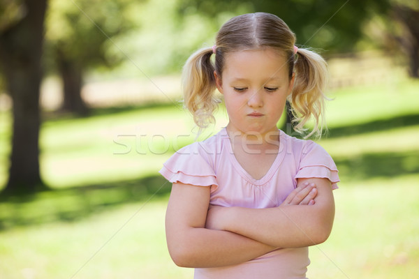Sad young girl with arms crossed at park Stock photo © wavebreak_media