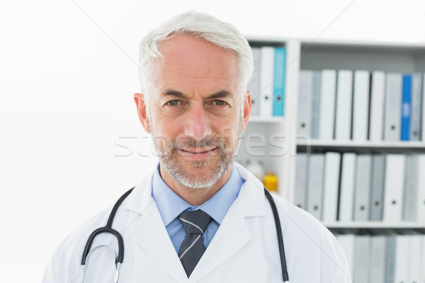 Smiling confident male doctor at medical office Stock photo © wavebreak_media