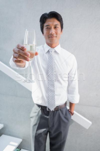 Happy man holding flute of champagne Stock photo © wavebreak_media