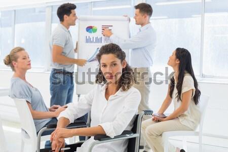 Casual businessman in wheelchair listening to presentation Stock photo © wavebreak_media