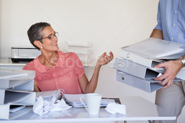 Casual businesswomans workload getting bigger and bigger Stock photo © wavebreak_media