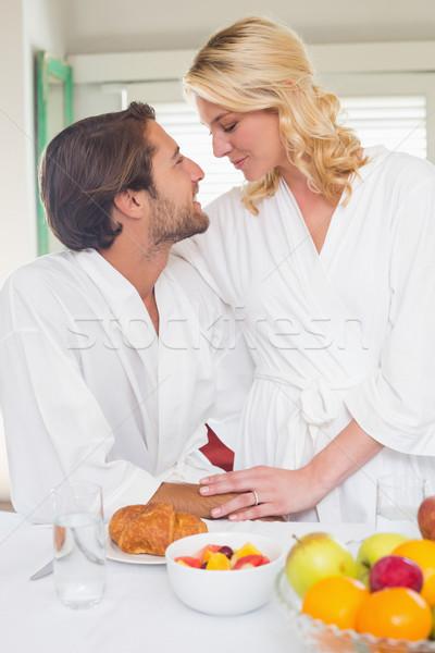 Bonitinho casal café da manhã juntos casa sala de estar Foto stock © wavebreak_media