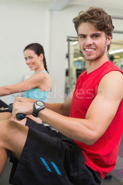 Smiling man working out on the rowing machine Stock photo © wavebreak_media