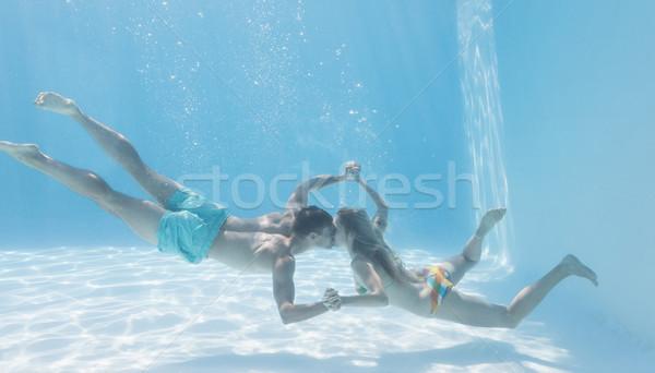 Cute para trzymając się za ręce podwodne basen wakacje Zdjęcia stock © wavebreak_media