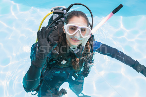 Smiling woman on scuba training in swimming pool making ok sign Stock photo © wavebreak_media