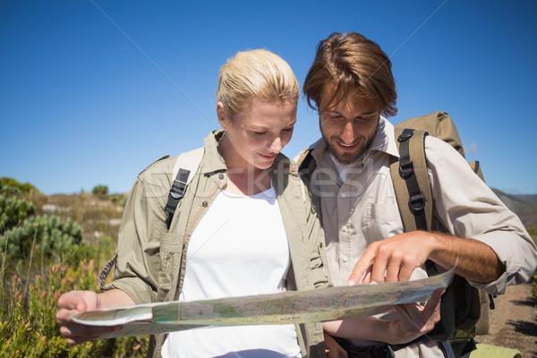 Kirándulás pár sétál hegy terep néz Stock fotó © wavebreak_media