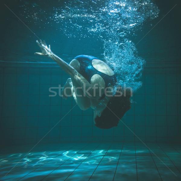 Athletic swimmer doing a somersault underwater Stock photo © wavebreak_media