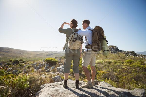 Caminhadas casal olhando fora país terreno Foto stock © wavebreak_media