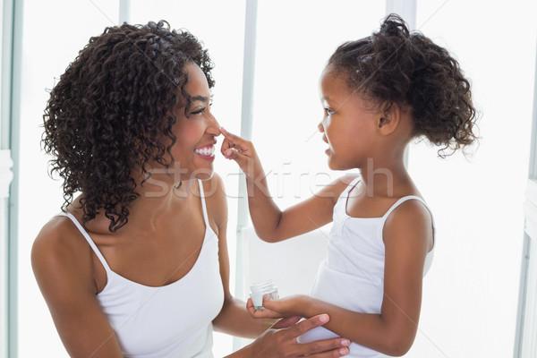 Cute figlia crema per il viso madri naso home Foto d'archivio © wavebreak_media
