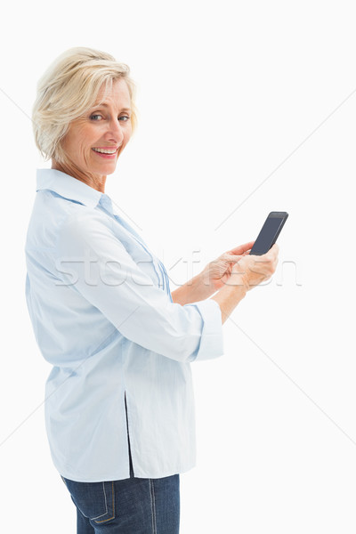 Boldog érett nő küldés szöveg fehér kommunikáció Stock fotó © wavebreak_media