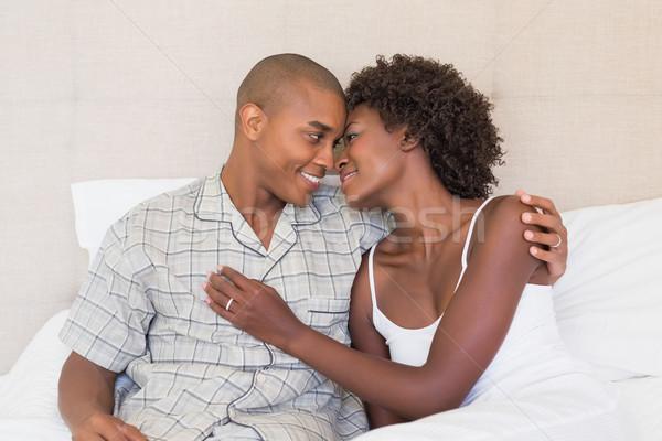 ストックフォト: 幸せ · カップル · 座って · ベッド · ホーム