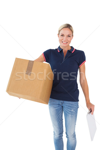 Happy delivery woman holding cardboard box and clipboard Stock photo © wavebreak_media