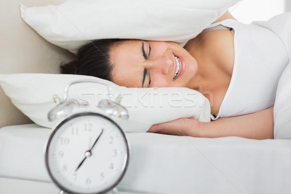 Nő fülek párna ágy ébresztőóra oldal Stock fotó © wavebreak_media