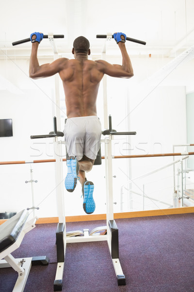 Rear view of body builder doing pull ups at gym Stock photo © wavebreak_media