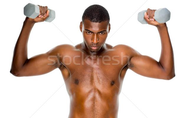 Déterminé s'adapter torse nu homme haltères Photo stock © wavebreak_media