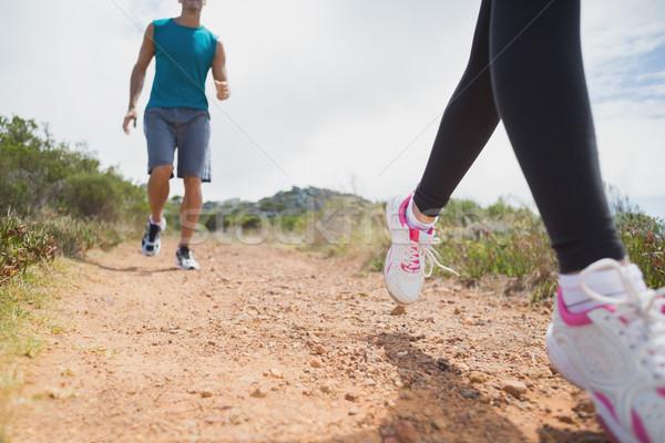 Couple running on countryside road Stock photo © wavebreak_media