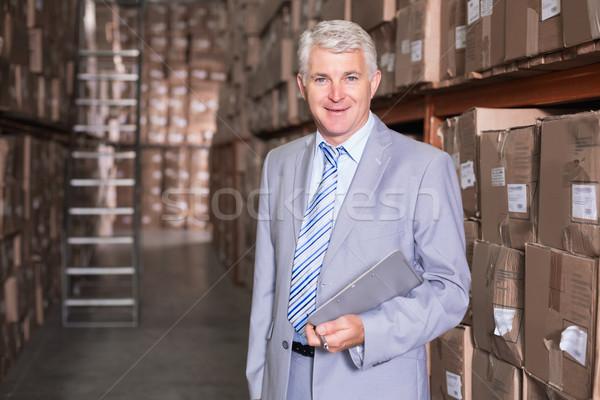Entrepôt gestionnaire souriant caméra affaires affaires Photo stock © wavebreak_media