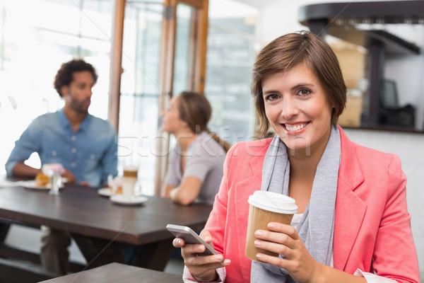 Ziemlich Brünette Text trinken Kaffee Stock foto © wavebreak_media