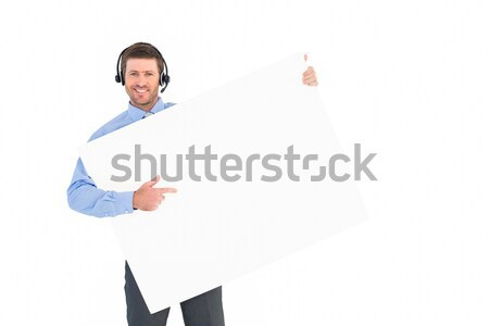 Businessman showing card wearing headset Stock photo © wavebreak_media