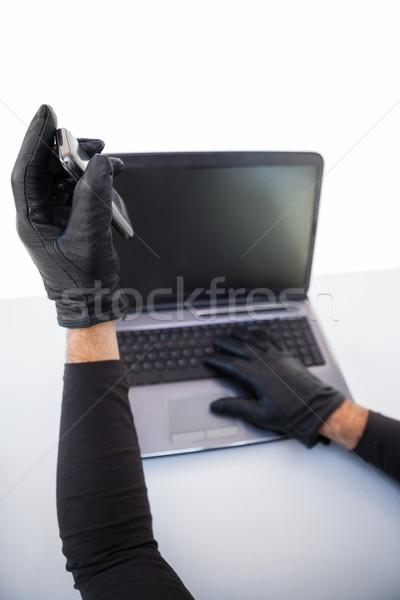 Stock fotó: Betörő · hackelés · laptop · mobiltelefon · fehér · technológia