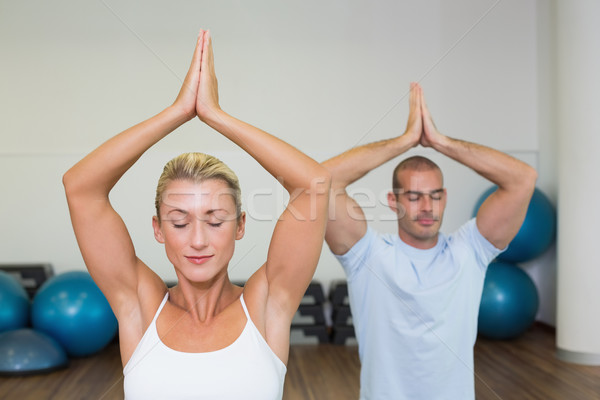Couple with joined hands and eyes closed at fitness studio Stock photo © wavebreak_media