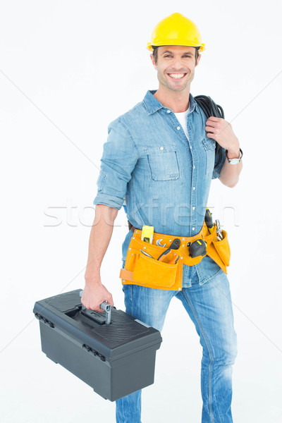 Happy electrician with tool box and wire Stock photo © wavebreak_media