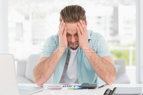 Stressed businessman covering his face at his desk Stock photo © wavebreak_media