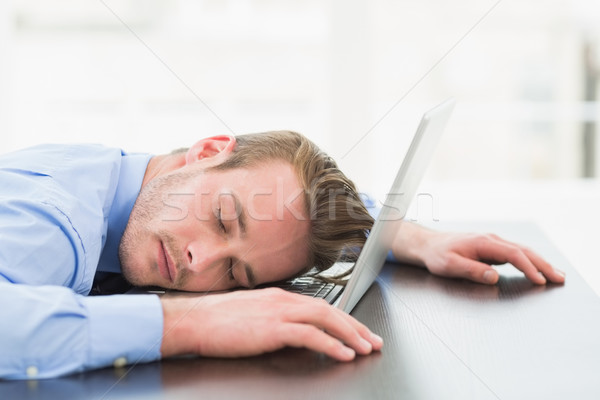 Businessman sleeping on his laptop Stock photo © wavebreak_media