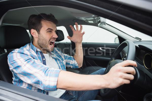 Młody człowiek drogowego wściekłość samochodu okno gniew Zdjęcia stock © wavebreak_media