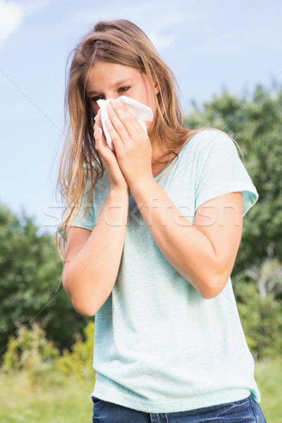 Joli moucher femme herbe Photo stock © wavebreak_media