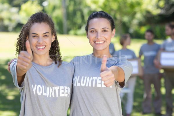 Boldog önkéntesek park napos idő kezek férfi Stock fotó © wavebreak_media