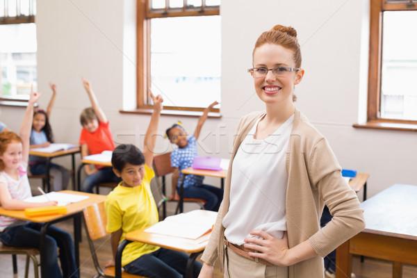 Alunos mãos classe escola primária menina escolas Foto stock © wavebreak_media