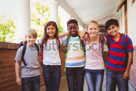 Sorridere piccolo scuola ragazzi corridoio ritratto Foto d'archivio © wavebreak_media