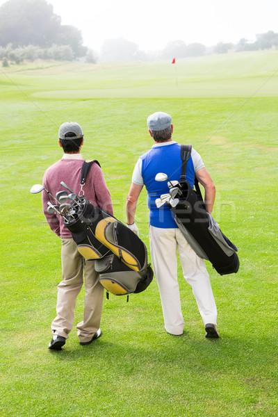 гольфист друзей ходьбе гольф человека Сток-фото © wavebreak_media