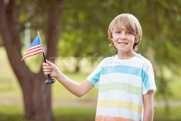 Young boy holding an american flag Stock photo © wavebreak_media