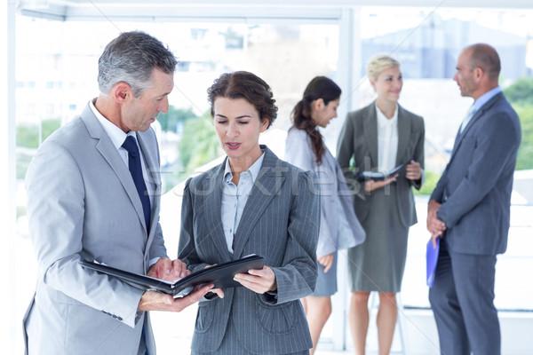 üzletemberek tárgyal iroda boldog notebook csapat Stock fotó © wavebreak_media