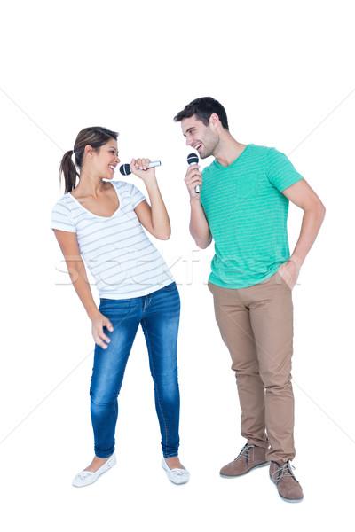 Iki arkadaşlar şarkı söyleme mikro beyaz adam Stok fotoğraf © wavebreak_media