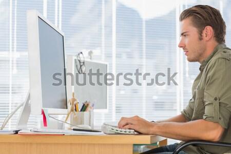 Adam çalışma büro bilgisayar yandan görünüş genç Stok fotoğraf © wavebreak_media