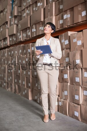 Female manager with arms crossed in warehouse Stock photo © wavebreak_media