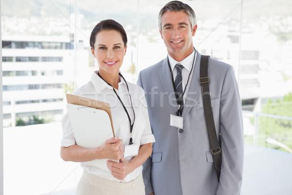 Businessman standing with co worker Stock photo © wavebreak_media