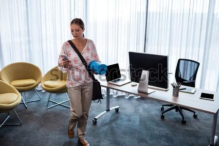 Technician sitting on swivel chair using laptop to diagnose serv Stock photo © wavebreak_media