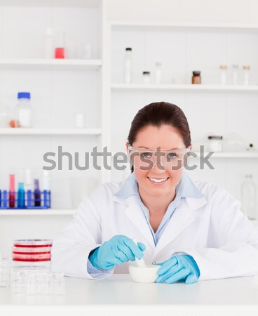 Smiling hairdresser with hair products Stock photo © wavebreak_media